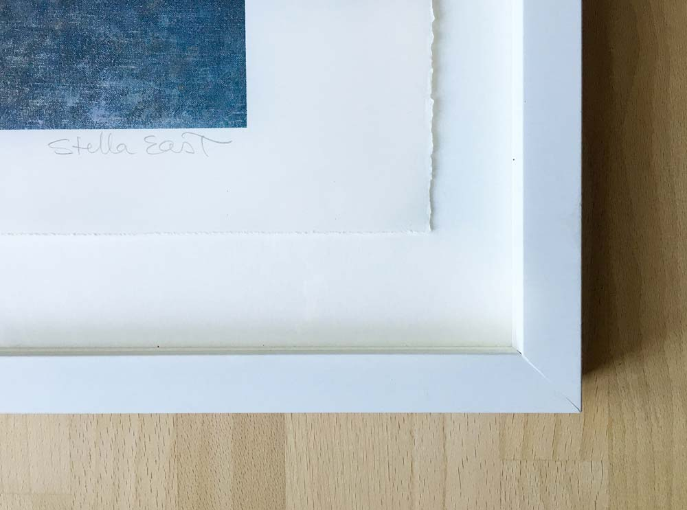 """Corner of the framed """"Sleeping Boy"""" showing the cotton paper edge and signature - without the black copyright notice. ©Stella East"""